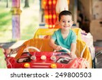 Happy Smilling Boy Driving Car...