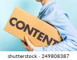 "Small photo of Content marketing distribution concept. Woman carrying a box with the word ""content"" in front."