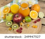 sweet juice and fruits on wood | Shutterstock . vector #249947527