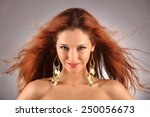 red haired girl with flying...