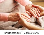 old and young holding hands on... | Shutterstock . vector #250119643