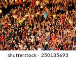 Blurred Crowd Of People In A...