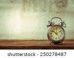 Retro Alarm Clock On Table In...