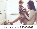 mother with her baby playing... | Shutterstock . vector #250656247