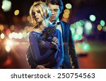 attractive young couple posing | Shutterstock . vector #250754563