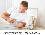 portrait of young man lying on... | Shutterstock . vector #250756987