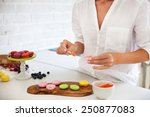 woman cooking homemade macarons ... | Shutterstock . vector #250877083