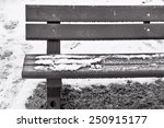 Part Of A Park Bench With Snow...