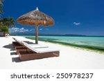 Sun Umbrella And Beach Beds On...