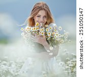 Beautiful Woman Enjoying Daisy...