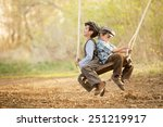 two young children on a swing... | Shutterstock . vector #251219917