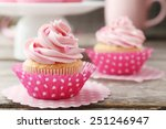 tasty cupcake on grey wooden...