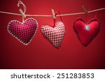 colorful fabric hearts on red... | Shutterstock . vector #251283853