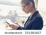 businesswomen using a digital... | Shutterstock . vector #251381827