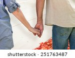 couple holding hands in park... | Shutterstock . vector #251763487