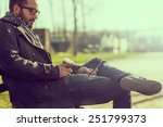 Young Man Sitting On A Bench ...