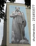 Small photo of PRAGUE, CZECH REPUBLIC - JUNE 13, 2014: Huge banner depicted Russian president Vladimir Putin dressed as Josef Stalin and with Adolf Hitler moustache on the DOX Centre in Prague, Czech Republic.