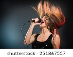 a young woman rock singer with... | Shutterstock . vector #251867557