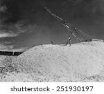 Small photo of Nitrate mounds at Pedro de Valdivia, Chile in 1944. The whitish substance, caliche, was rich in sodium nitrate. Nitrates are the active ingredient of bombs and bullets.