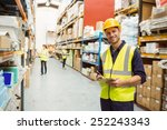 warehouse worker smiling at... | Shutterstock . vector #252243343