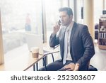 business man with tablet... | Shutterstock . vector #252303607