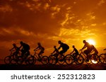 Small photo of Image of sporty company friends on bicycles outdoors against sunset. Silhouette A lot phases of motion go of ten 10 cyclist along shoreline coast Reflection sun on water Copy Space for inscription