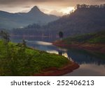 Small photo of Mountain Adam's Peak at sunset with reflection in the lake. Sri Lanka