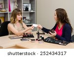 Small photo of Beauty consultant business card transmits office staff