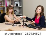 Small photo of Beauty consultant sends the customer a business card