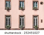 Pink Facade Of A Building With...