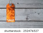 Small photo of Fire sale concept with a sale tag on wooden table