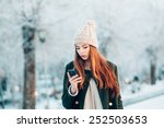 young woman in winter park... | Shutterstock . vector #252503653