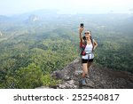 Woman Hiker Taking Photo With...
