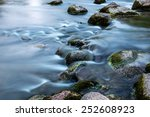 Rocks In Stream With Smooth...