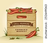 retro crate of chili peppers.... | Shutterstock .eps vector #252649063