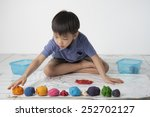 a boy playing colorful dough on ... | Shutterstock . vector #252702127
