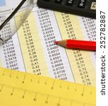 Small photo of Degrees and radians mathematical table together with glasses, red pencil, measurement and calculator