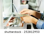 Stock photo female hand with money in cash department window currency exchange concept 252812953