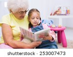 grandmother teaches to read a... | Shutterstock . vector #253007473