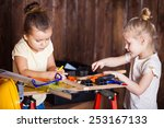 two little girls making very... | Shutterstock . vector #253167133