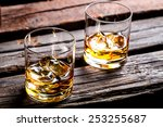two glasses with ice and whiskey | Shutterstock . vector #253255687