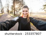 young sporty woman taking a... | Shutterstock . vector #253357807