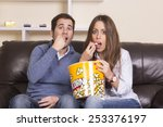 couple watching film on sofa... | Shutterstock . vector #253376197
