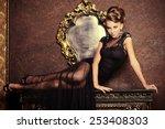 elegant young woman in black... | Shutterstock . vector #253408303