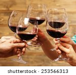 Clinking Glasses Of Red Wine I...
