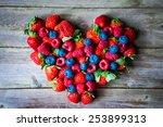 heart of berries on wooden... | Shutterstock . vector #253899313