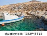 fishing motorboat near rocky... | Shutterstock . vector #253945513