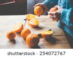 Fresh Oranges On Wooden Table....