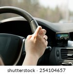 a woman's hand on the steering... | Shutterstock . vector #254104657