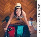cheerful female packing... | Shutterstock . vector #254142283